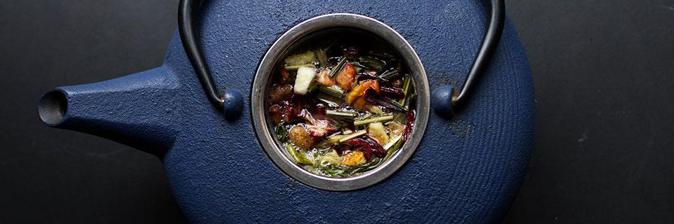 herb and flower-filled blue teapot courtesy Unsplash