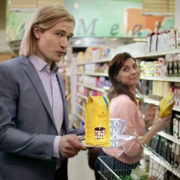 Gevalia Kaffe's TV ad man Johan in a grocery store aisle with a female shopper.